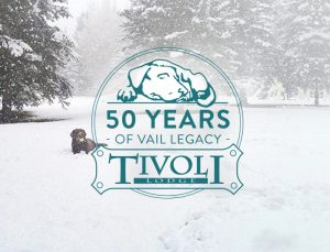 50 Years of Vail Legacy at Tivoli Lodge logo with chocolate labrador playing in the snow.