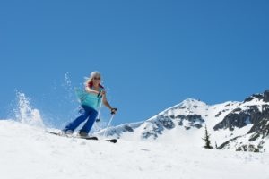 female skiing in the spring
